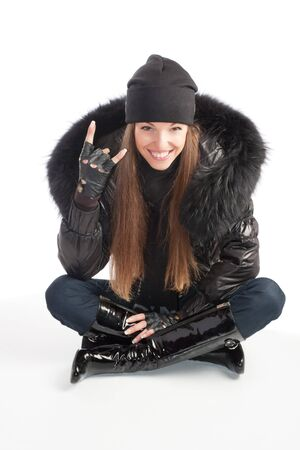 Girl in black clothes showing I love you gesture photo