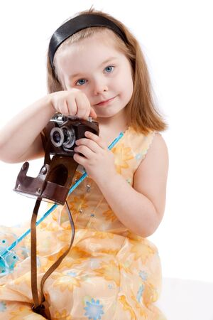 Girl holding retro-styled camera, isolated photo