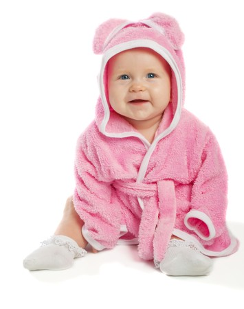 Cheerful baby sitting in pink bath gown, isolated photo