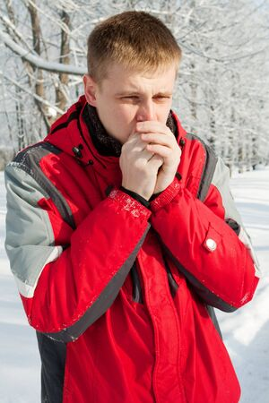 Man warming up his hands outdoors Stock Photo - 4102586