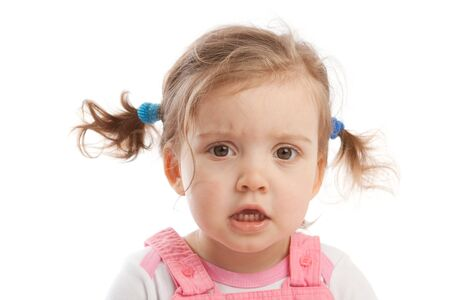 Portrait of an angry cute little girl photo