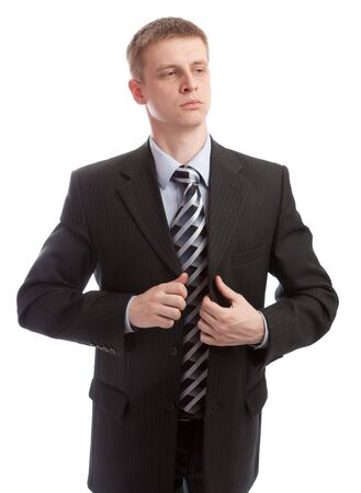 Businessman buttons his suit, isolated photo