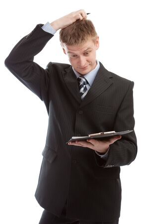 Man reading the document and scratching his head photo