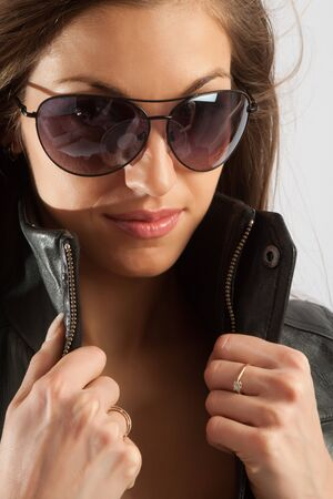 Portrait of a lovely female in sunglasses photo