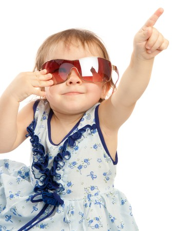 Little girl in sunglasses pointing upward photo
