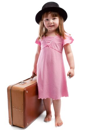 Girl with old shabby suitcase photo