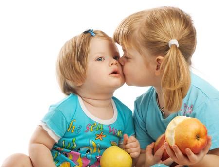 Elder sister kissing her little one Stock Photo - 4173860