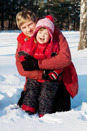 Happy father and daughter in winter wood Stock Photo - 4178915