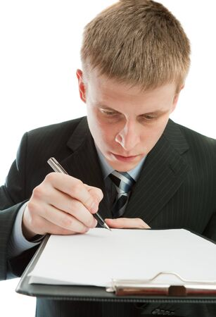 Man signing contract or another document photo