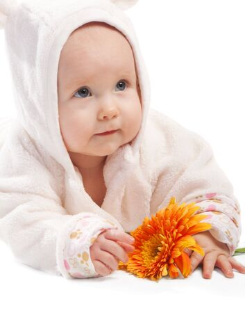 Lovely baby with orange flower photo