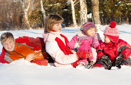 Winter happiness - family playing in the snow Stock Photo - 4202427