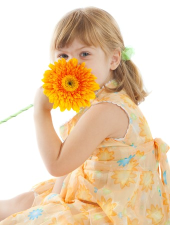 Happy red-heaired girl with orange daisy