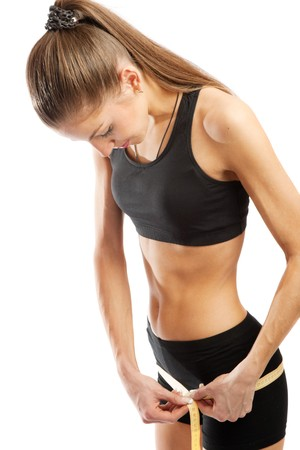 Young athletic girl measuring hips, isolated Stock Photo - 4332863