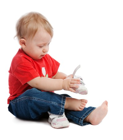 Child trying on trainers, isolated Stock Photo - 4383458
