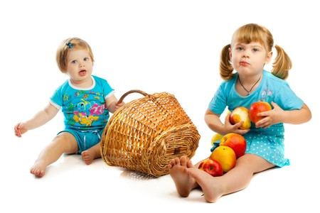 Two lovely kids playing with fruit and wicker basket Stock Photo - 4420739