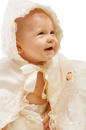 baptismal: Lovely baby in baptismal hooded clothes Stock Photo