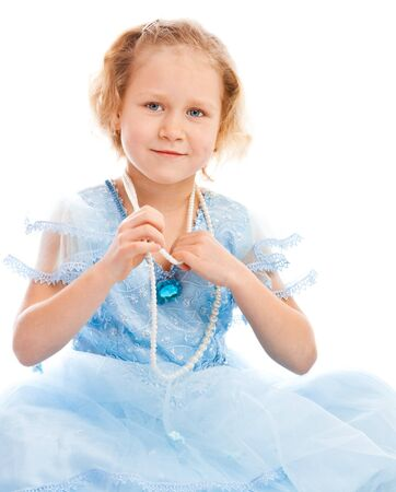 Lovely girl in blue dress and beads Stock Photo - 4438258