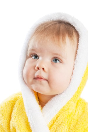 Baby in yellow bath gown looking up photo