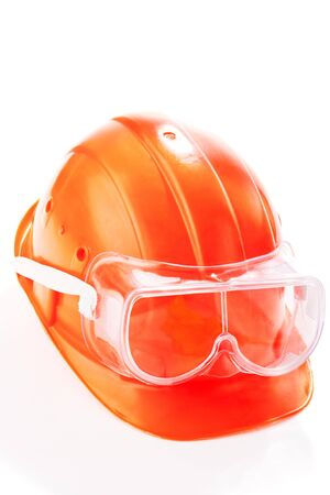 An orange safety helmet with protective goggles Stock Photo - 4514599