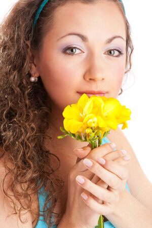 Lovely young woman with yellow freesia photo