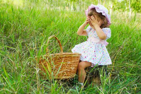 peekaboo: Little girl playing peekaboo in the wood