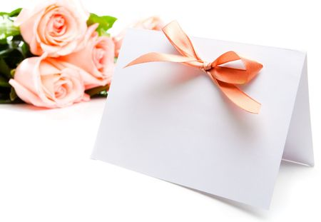 pink wedding: Blank invitation card and roses on background