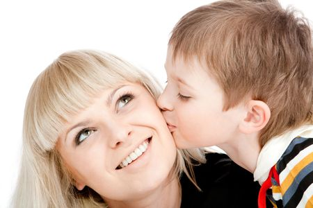 Boy kissing his mother, isolated photo