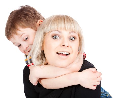 Portrait of happy mother and son playing together photo
