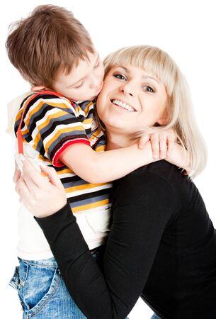 Preschool boy kissing his mother photo