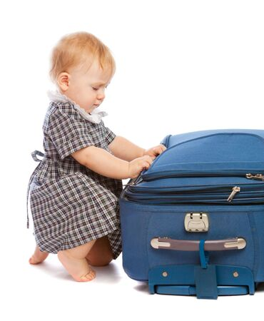 Baby making the suitcase ready for summer vacation Stock Photo - 4749429