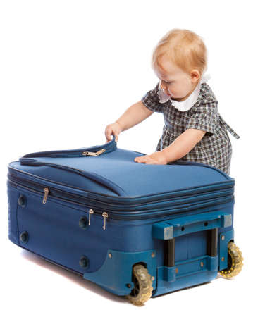 Baby trying to open a suitcase Stock Photo - 4754059
