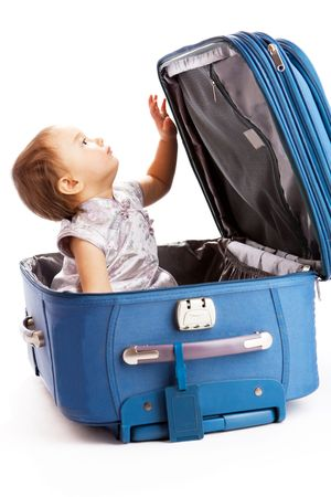 Baby girl sits inside the suitcase Stock Photo - 4750774