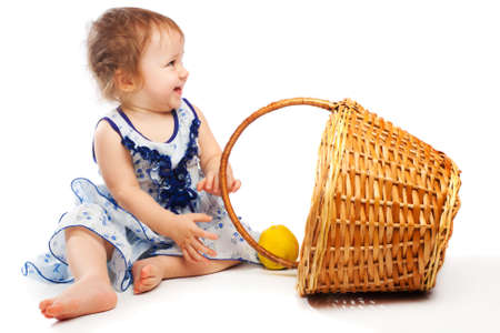 Laughing baby girl sitting near wicker basket Stock Photo - 4750819
