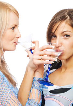 Pretty girls drinking vermouth, isolated photo