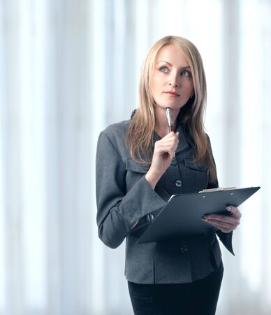 Woman holding clipboard and pen, isolated photo