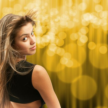 Attractive girl turning her head, hair flying away Stock Photo - 4771286