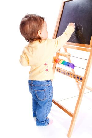 infant girl: Baby drawing on the blackboard, isolated