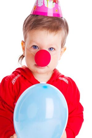 Baby with clown nose and party hat photo
