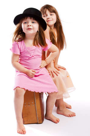 Two kids sitting on the old suitcase Stock Photo - 4798708