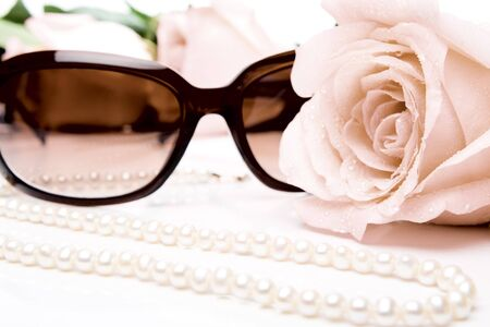 Roses, pearl necklace and sunglasses photo