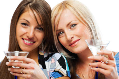 Two pretty friends celebrating, isolated Stock Photo - 4827793