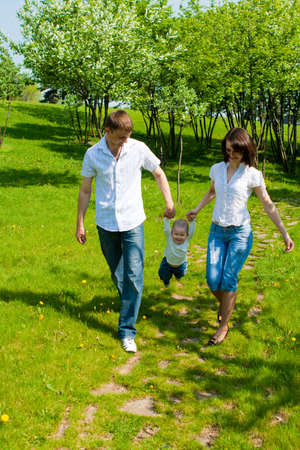 Family walking in the summer park Stock Photo - 4840935