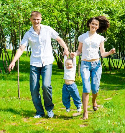 Family walking in the summer park Stock Photo - 4861210