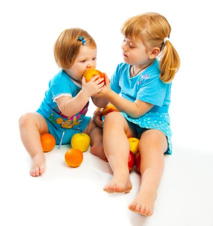 Lovely kids eating apples, isolated photo