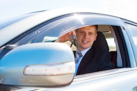 Smiley businessman showing his new car keys photo