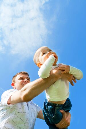 Baby boy flying on his father's hands Stock Photo - 4881815