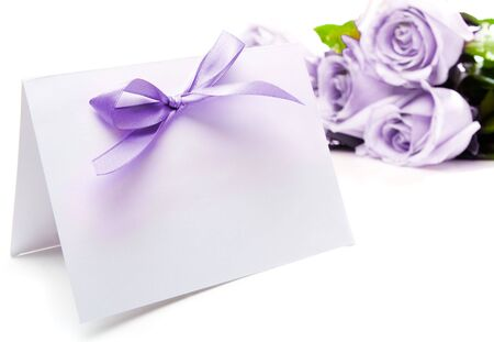 holiday display: Purple greeting card and roses Stock Photo