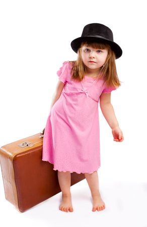barefooted: Barefooted kid carrying an old heavy suitcase Stock Photo
