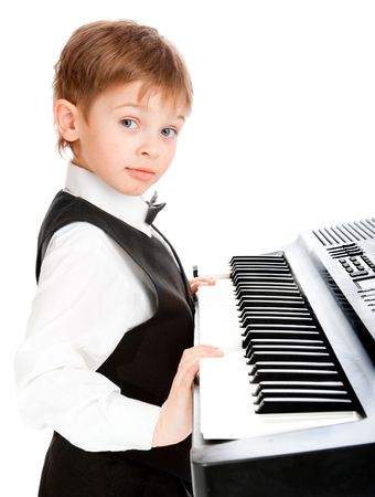 prodigy: Little prodigy pianist looking at the camera Stock Photo