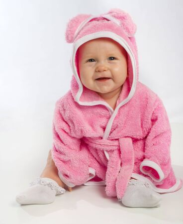 Smiling baby in pink bathrobe photo